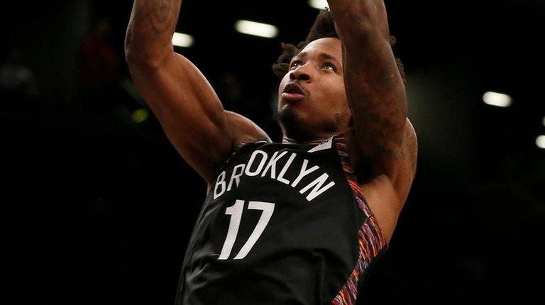Ed Davis of the Nets dunks the ball