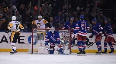 New York Rangers goaltender Alexandar Georgiev and teammates