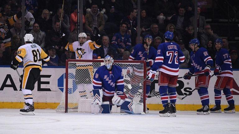 New York Rangers goaltender Alexandar Georgiev and teammates