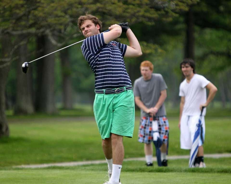 Manhasset's Bennett Linsky hits a drive during the
