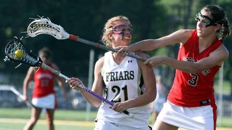 St. Anthony's Kasey Behr tries to escape the