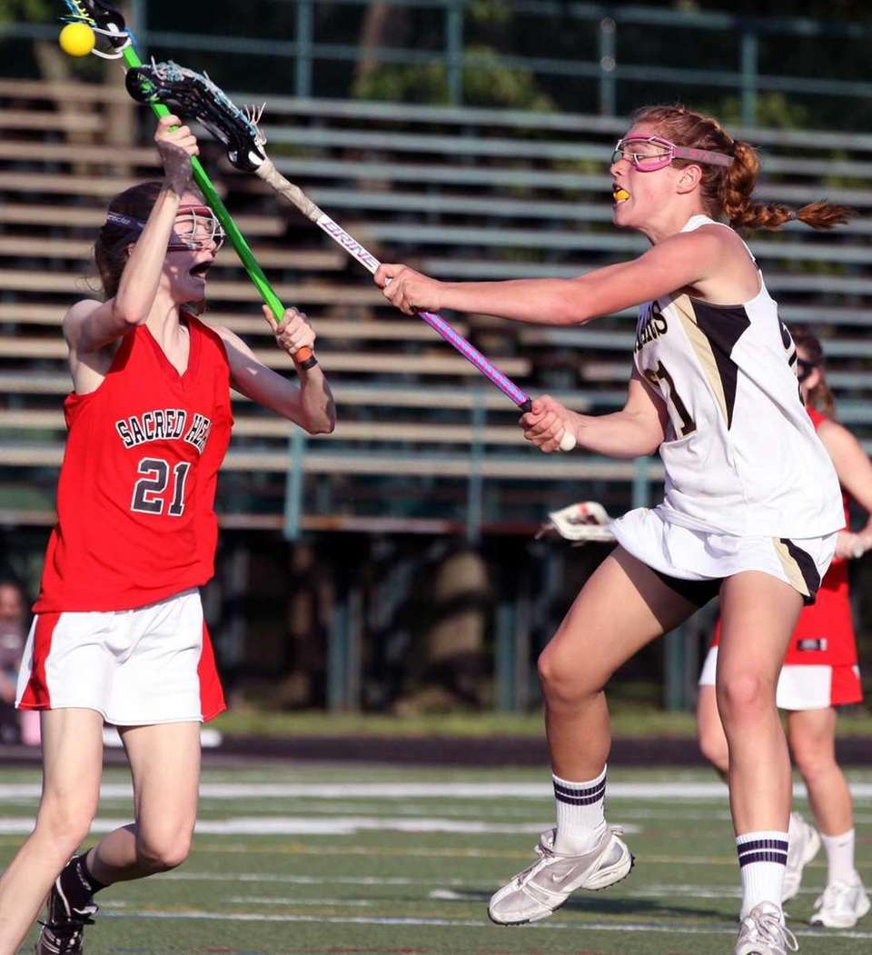 St. Anthony's Kasey Behr, right, scores against Sacred