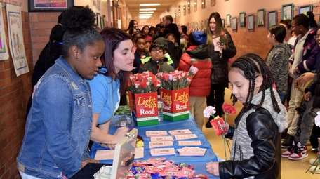 In Elmont, Mariah Champagne, left, a member of