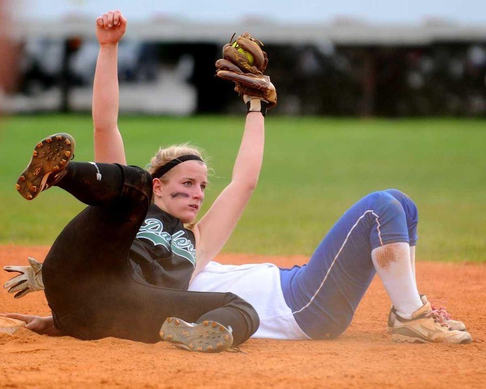 Farmingdale shortstop Kat Zabielski hangs on to the
