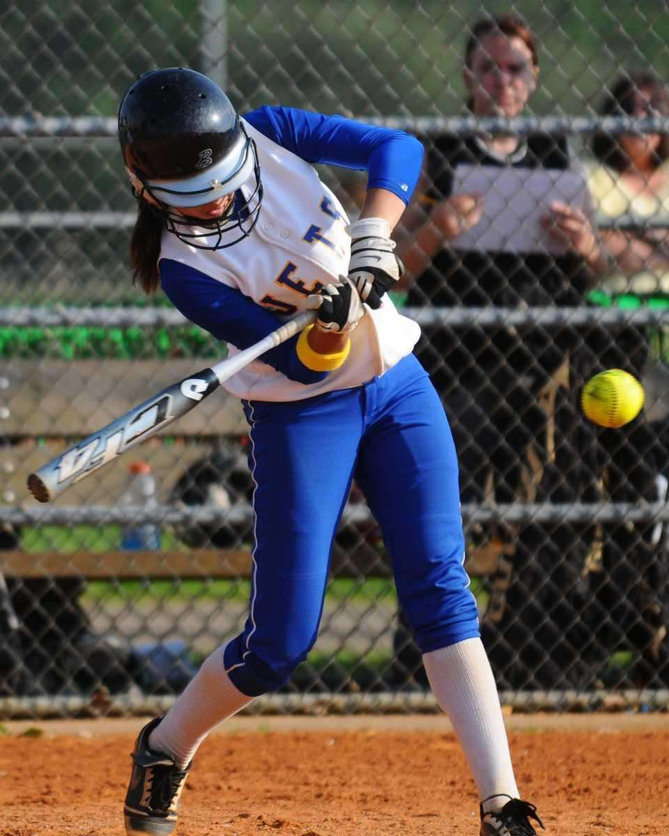 East Meadow's Taylor Conti drives in a run