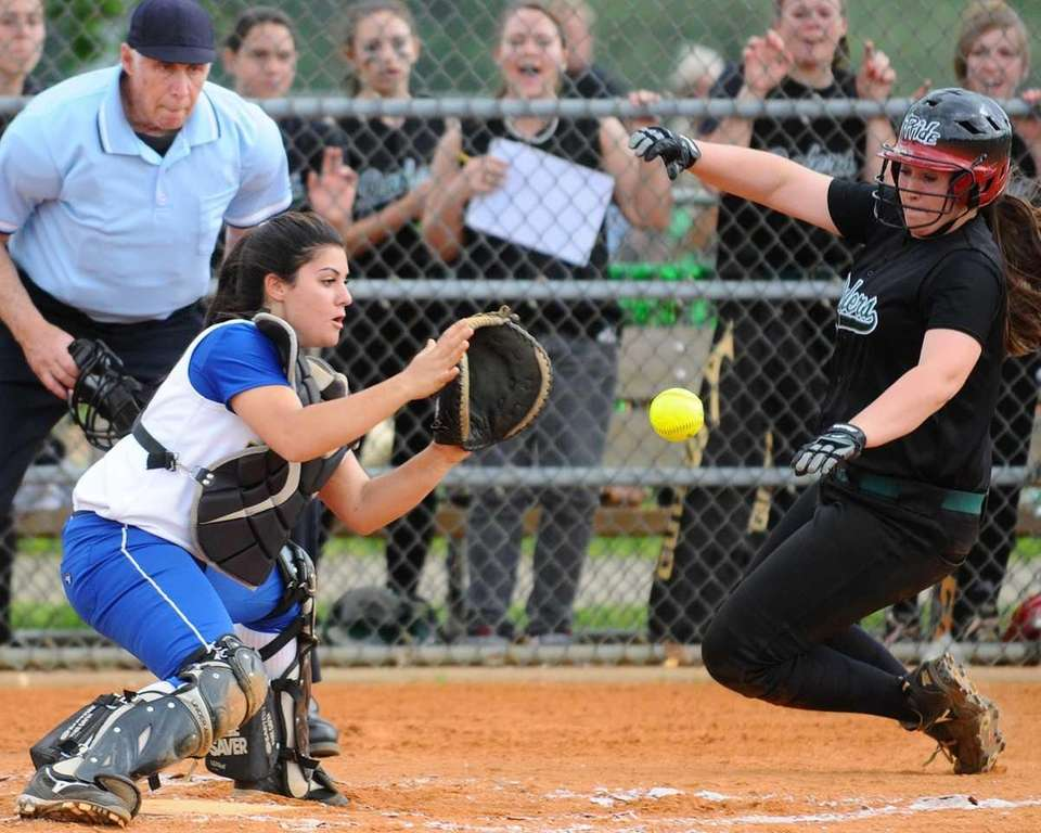 Farmingdale's Isabella Corrao, right, is tagged out at