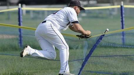 Smithtown West's Anthony Gatto runs into the fence