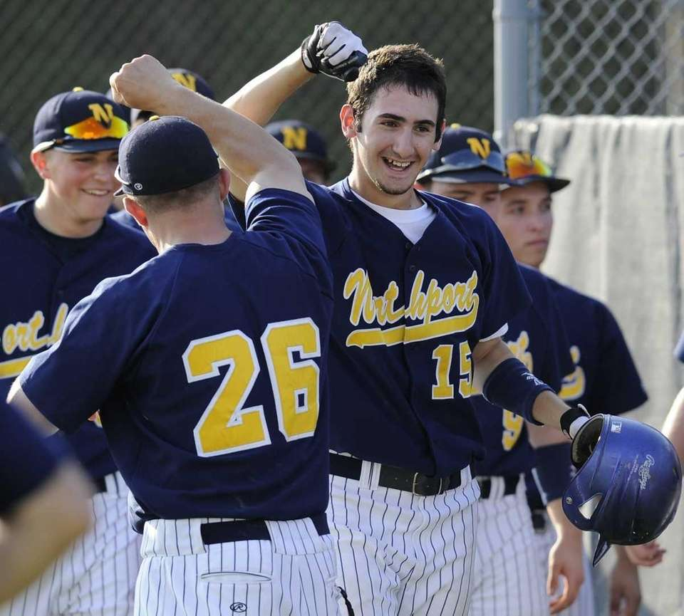 Northport's Matt Lertora celebrates with his team during