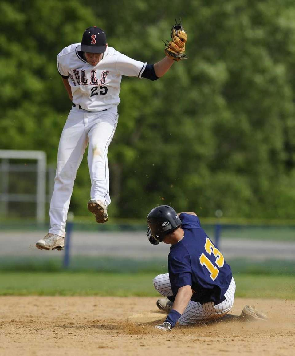Northport's Andrew Lertora steals second base as Smithtown