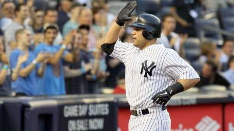 The Yankees' Russell Martin celebrates his second-inning home