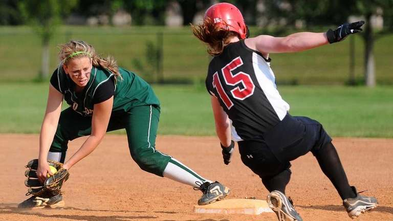 Seaford shortstop Victoria Wink, left, tries to tag