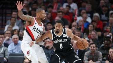 Portland Trail Blazers guard Damian Lillard, left, defends