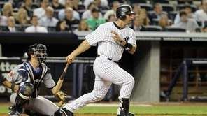 Jorge Posada follows through on a ninth-inning pinch