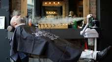 Cesar Torres, co-owner of Noble Savage Barbershop in