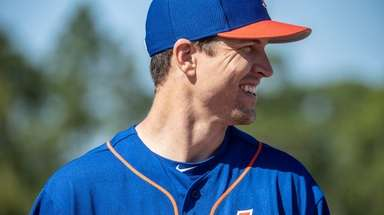 Mets pitcher Jacob deGrom looks on during a