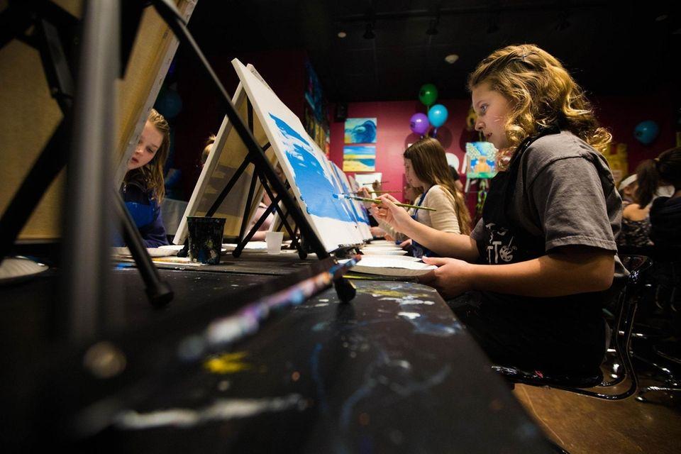 Ciena Souhrada of Bay Shore paints at a