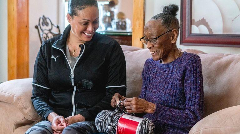 Della Barrett, right, has more time to crochet
