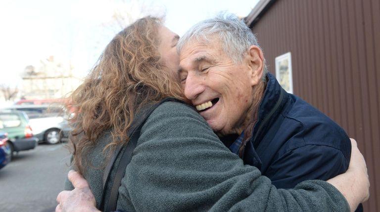 Arnold Herman, 88, hugs his daughter, Andrea Vocke,