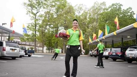 Samantha Schindler, 17, delivers orders on roller skates