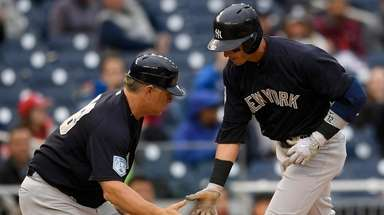 The Yankees' Troy Tulowitzki (right) celebrates his home