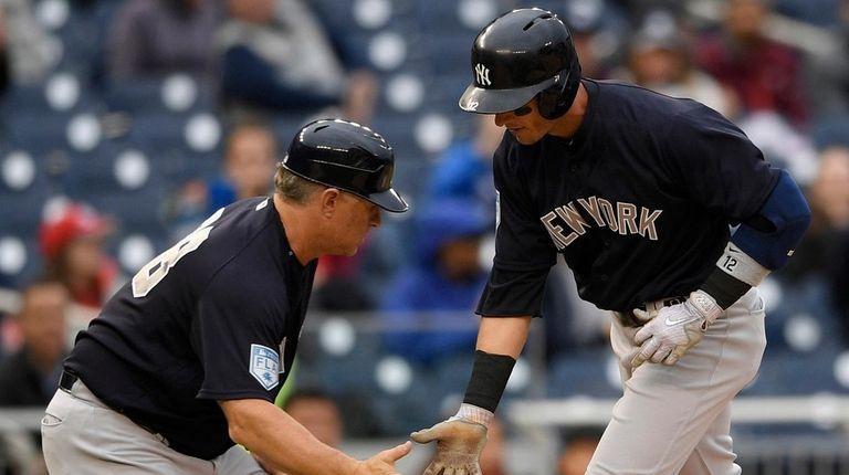 The Yankees' Troy Tulowitzki (right) celebrates his home
