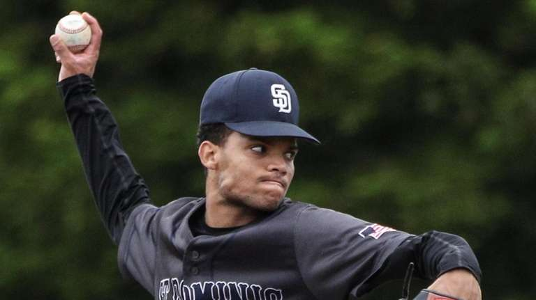 Starting pitcher Carlos Hidalgo of St. Dominic went