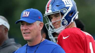 Giants quarterback Eli Manning watches as head coach