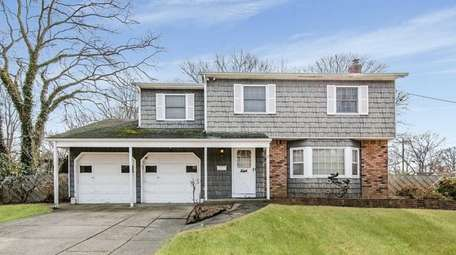 This Brentwood Colonial, for $409,000, includes four bedrooms
