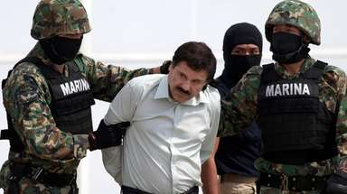 """Joaquin """"El Chapo"""" Guzman, center, is escorted to"""