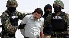 "Joaquin ""El Chapo"" Guzman, center, is escorted to"