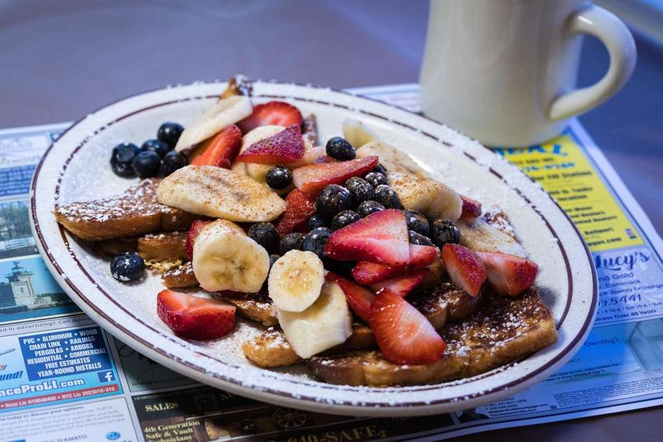 The French toast served with fresh fruit, a