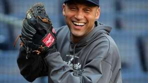 Derek Jeter laughs while warming up for an