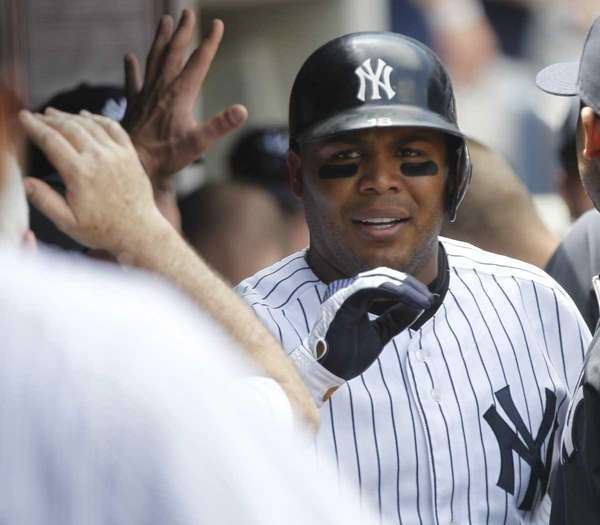 New York Yankees' Andruw Jones celebrates with teammates