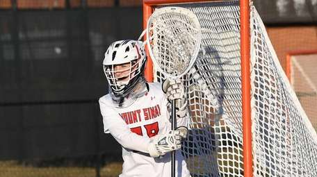 Mt. Sinai goalie Emily Lamparter protects the net