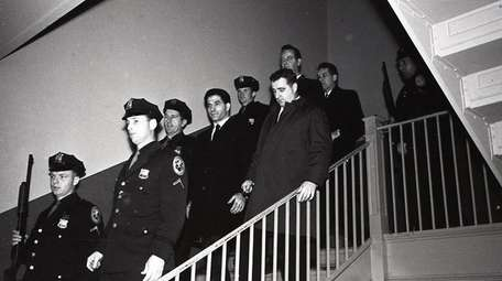 John (Sonny) Franzese is escorted down a staircase