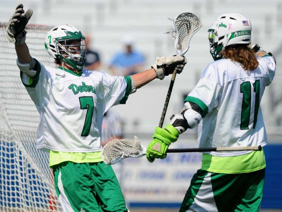 Farmingdale's Greg Catalano, left, celebrates after scoring a