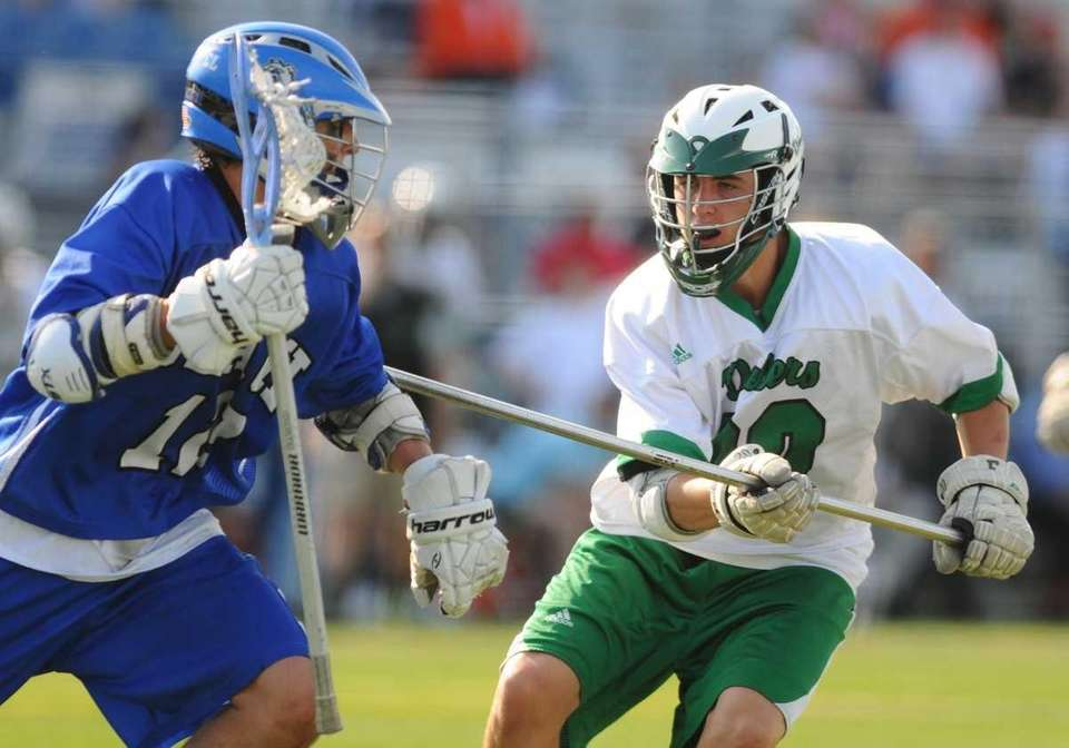 Farmingdale High School defenseman #50 Joe Ostrander, right,