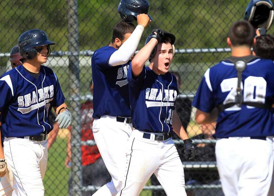 Eastport's Dave Griffiths (15) (center) celebrates with teammates