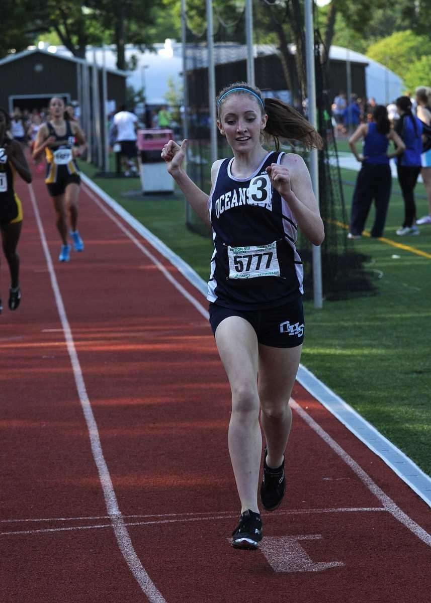 Oceanside's Katie Ryan smiles as she wins the