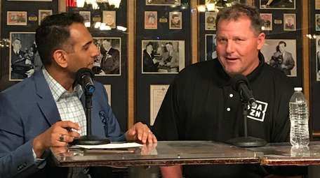 Adnan Virk and Roger Clemens speak Tuesday during