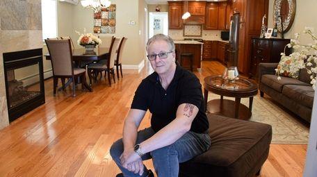 Guy Marino in his East Rockaway home.