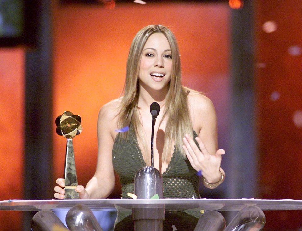 Mariah Carey accepts an award for Artist of