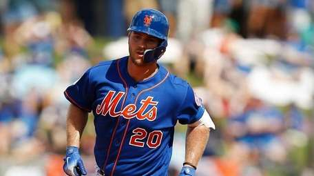 Pete Alonso rounds the bases after hitting a
