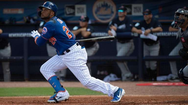 The Mets' Robinson Cano swings during a spring