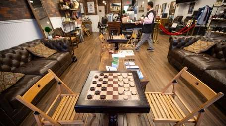 Customers can play checkers and chess at Sir