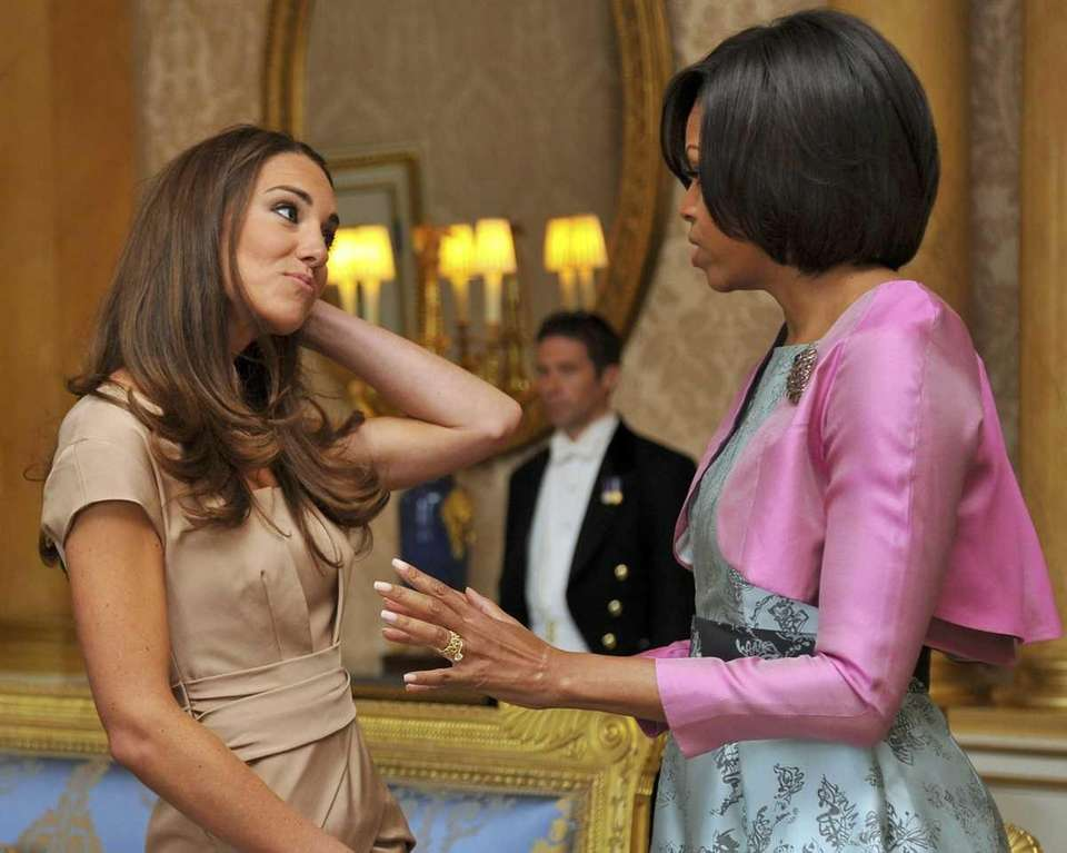 Britain's Catherine, Duchess of Cambridge, speaks with first