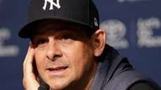 Yankees manager Aaron Boone speaks during a news