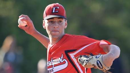 Connetquot's Joseph Savino scoops up a grounder and