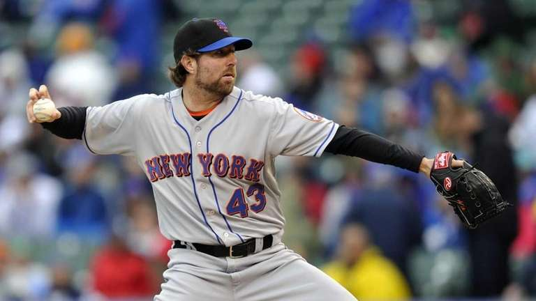 Mets starter R.A. Dickey pitches against the Cubs