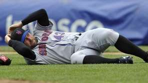 Mets starting pitcher R.A. Dickey lays on the